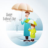 Father and son with umbrella for Fathers Day celebration. Stock Photography