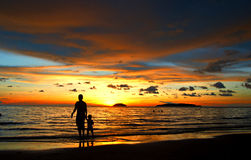 Father and Son under Sunset. Father and son walking beside a beach during sunset royalty free stock photography