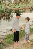 Father and son under a tree in the Indian pants Stock Photography