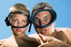 Father and son in underwater masks Royalty Free Stock Image