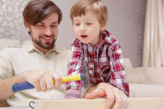 Father and son use hammer Royalty Free Stock Photography