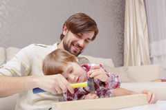 Father and son use hammer Royalty Free Stock Photos