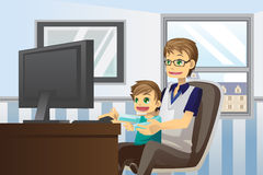 Father and son using computer Stock Image