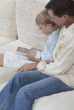 Father With Son Using Digital Tablet Stock Images