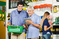 Father And Son Using Digital Tablet In Hardware Royalty Free Stock Photo