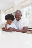 Father and son using digital tablet Stock Image