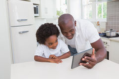 Father and son using digital tablet Royalty Free Stock Photo