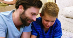 Father and son using a digital tablet stock video