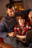 Father And Son Using Laptop Computer Stock Images