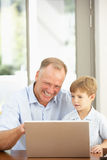 Father And Son Using Laptop At Home Royalty Free Stock Photography
