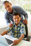 Father And Son Using Laptop At Home Royalty Free Stock Image