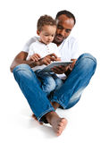 Father and son using tablet computer. Learning and early education concept Royalty Free Stock Photos