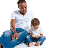 Father and son using tablet computer. Learning and early education concept Stock Photo