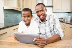 Father and son using tablet Royalty Free Stock Images