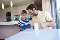 Father and son using tablet pc Stock Images