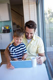 Father and son using tablet pc Stock Image