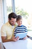 Father and son using tablet pc Royalty Free Stock Images