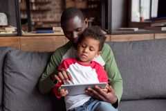 Father and son using tablet Stock Photo