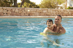Father And Son On Vacation Having Fun In Outdoor Pool Stock Image