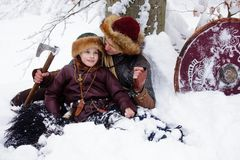 Portrait strong viking warrior winter woods battle scandinavian traditional clothing lumberjack chain mail leather spear deep fore. Father and son Vikings in a Stock Photography