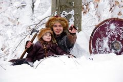 Portrait strong viking warrior winter woods battle scandinavian traditional clothing lumberjack chain mail leather spear deep fore. Father and son Vikings in a Royalty Free Stock Photo