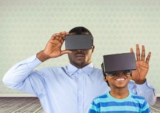 Father and son with VR headset in room. Digital composite of Father and son with VR headset in room Stock Image