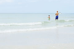 Father and son waiting for the waves Royalty Free Stock Photos