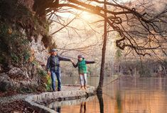 Father and son walk and play together near the autumn lake stock images