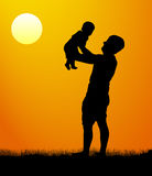 Father with son walk at sunset. Silhouette of a man with a child. vector illustration.  Stock Photo