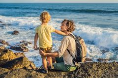 Father and son are walking along the cosmic Bali beach.. Portrait travel tourists - dad with kids. Positive human stock photography