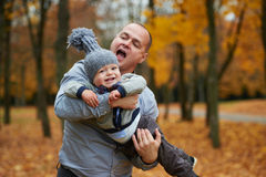 Father with son walking in autumn forest Royalty Free Stock Photography