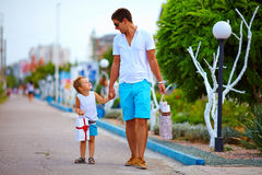Father and son walking colorful street, shopping Stock Photo