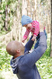 Father and son walking in forest Stock Image