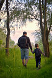Father and son walking in forest Royalty Free Stock Images