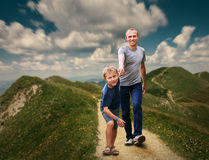 Father and Son walking on the highmountain footpath;. Father and Son walking on the highmountain footpath stock image
