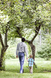 Father and son walking in nature Stock Image