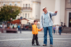 Father and son walking outdoors in city Royalty Free Stock Photo