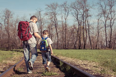 Father and son walking on the railway at the day time. Stock Photos