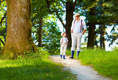 Father and son walking rural path in forest Stock Image