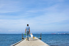 Father with son walking on the sea pier. Stock Photography
