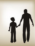 Father and Son Walking Together Stock Photo