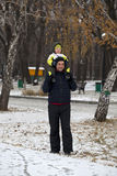 Father and son walking  in winter park Stock Image