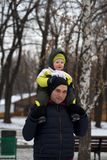 Father and son walking  in winter park Royalty Free Stock Photo