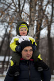 Father and son walking  in winter park Stock Images