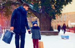 Father and son walking on winter shopping. Happy father and son walking on winter shopping Royalty Free Stock Photography