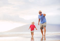 Father and son wallking on the beach Royalty Free Stock Image