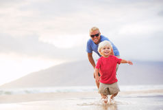Father and son wallking on the beach Royalty Free Stock Photography