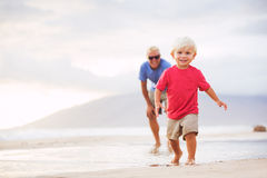 Father and son wallking on the beach Royalty Free Stock Photos