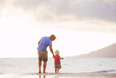 Father and son wallking on the beach Royalty Free Stock Images