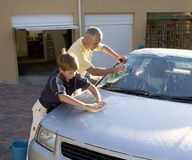 Father and son washing a car Stock Image